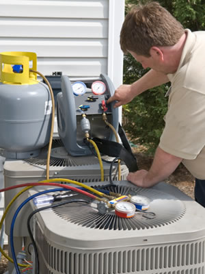 A man doing an air conditioning installation in St. Paul, MN